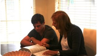 Nancy Polin tutoring male student